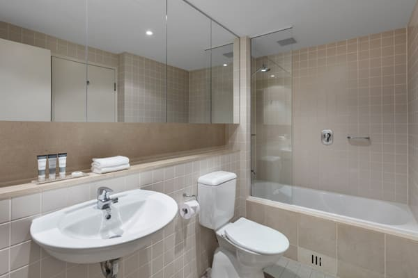 clean en suite bathroom of 2 bedroom ocean view apartment with air conditioning and Wi-Fi at hotel in Glenelg, South Australia