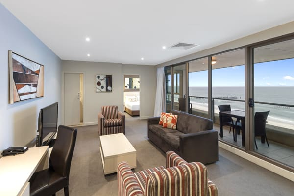 interior of large air conditioned 2 Bedroom Apartment on beach with private balcony views of the ocean at Oaks Plaza Pier hotel in Glenelg, South Australia