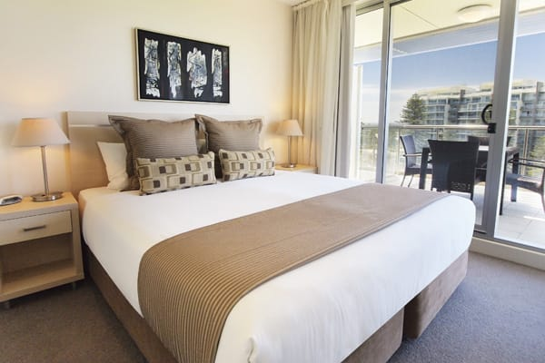 Hotels Glenelg with air con and king size bed in 3 Bedroom Apartment with fully furnished private balcony at Oaks Plaza Pier hotel in Glenelg, South Australia