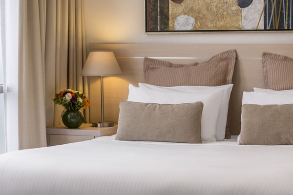 comfortable pillows on double bed with clean white sheets in 1 bedroom apartment with Wi-Fi access at Oaks on Lonsdale St hotel, Melbourne city, Victoria, Australia