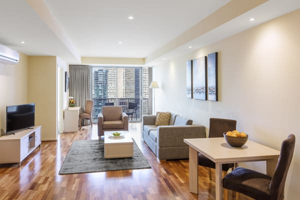 big, air conditioned 2 bedroom hotel apartment with free Wi-Fi access, private balcony, comfortable couches and TV with Foxtel at Oaks on Lonsdale hotel, Melbourne city, Victoria, Australia