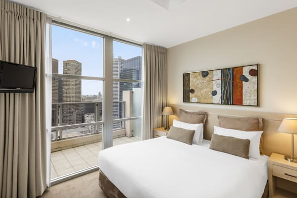 double bed in large 2 Bedroom hotel Apartment with Wi-Fi for corporate travellers and private balcony with views of Melbourne city at Oaks On Lonsdale