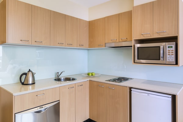 kettle, fridge, microwave and dishwasher in 3 Bedroom Apartment at Oaks On Lonsdale hotel in Melbourne CBD near Flinders Street Railway Station, Victoria, Australia