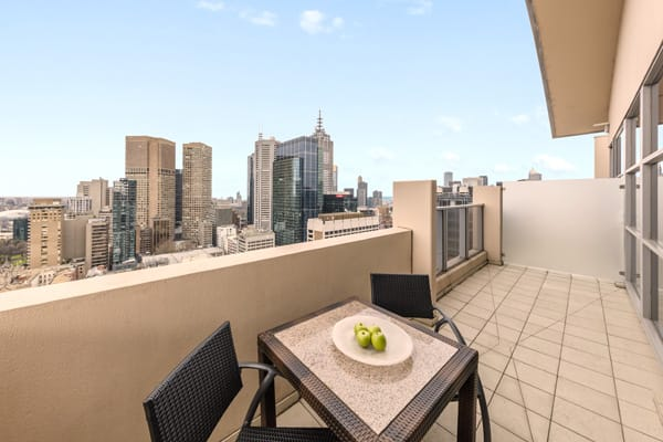 vegetarian breakfast on table on big private balcony of Hotel Apartment with views of Melbourne city at Oaks On Lonsdale street, Victoria, Australia