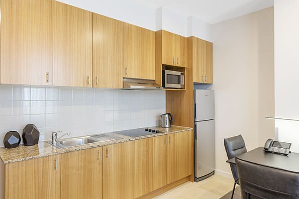 open plan Melbourne serviced apartments in hotel with air con, kitchenette with kettle and microwave and Wi Fi access at Oaks on Market in Victoria, Australia