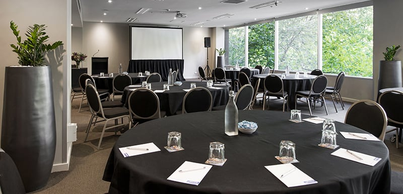round tables in air conditioned Conference Room for hire with projector for presentations at Oaks on Market hotel in Melbourne city, Victoria, Australia