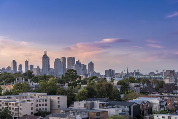 panoramic view of Melbourne CBD at sunset with blue skies and clouds from private balcony of 1 bedroom apartment at Oaks South Yarra hotel, Victoria, Australia