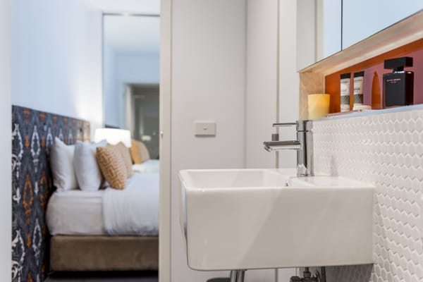 en suite bathroom with lockable sliding doors leading to air conditioned Studio Apartment with Wi-Fi at Oaks South Yarra hotel, Melbourne CBD, Victoria, Australia