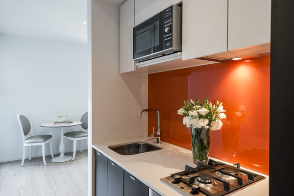 microwave and stove cook plates in kitchen area of Studio Apartment with Wi-Fi in Melbourne CBD at Oaks South Yarra hotel, Victoria, Australia