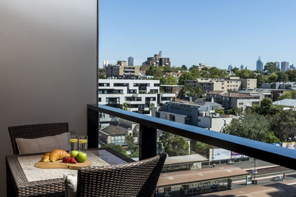 private balcony of Studio Apartment at Oaks South Yarra hotel with views of Melbourne city, double bed and free Wi-Fi access