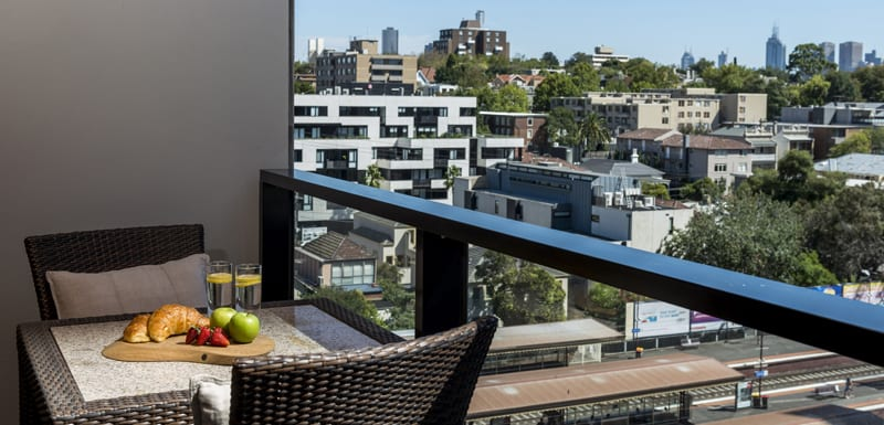 vegetarian breakfast option on table on small private balcony of hotel studio apartment in Melbourne CBD at Oaks South Yarra, Victoria, Australia