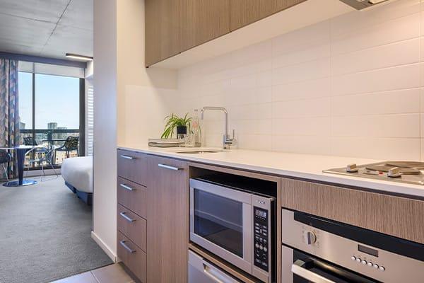 Oaks Melbourne on William Suites Studio Park Kitchen