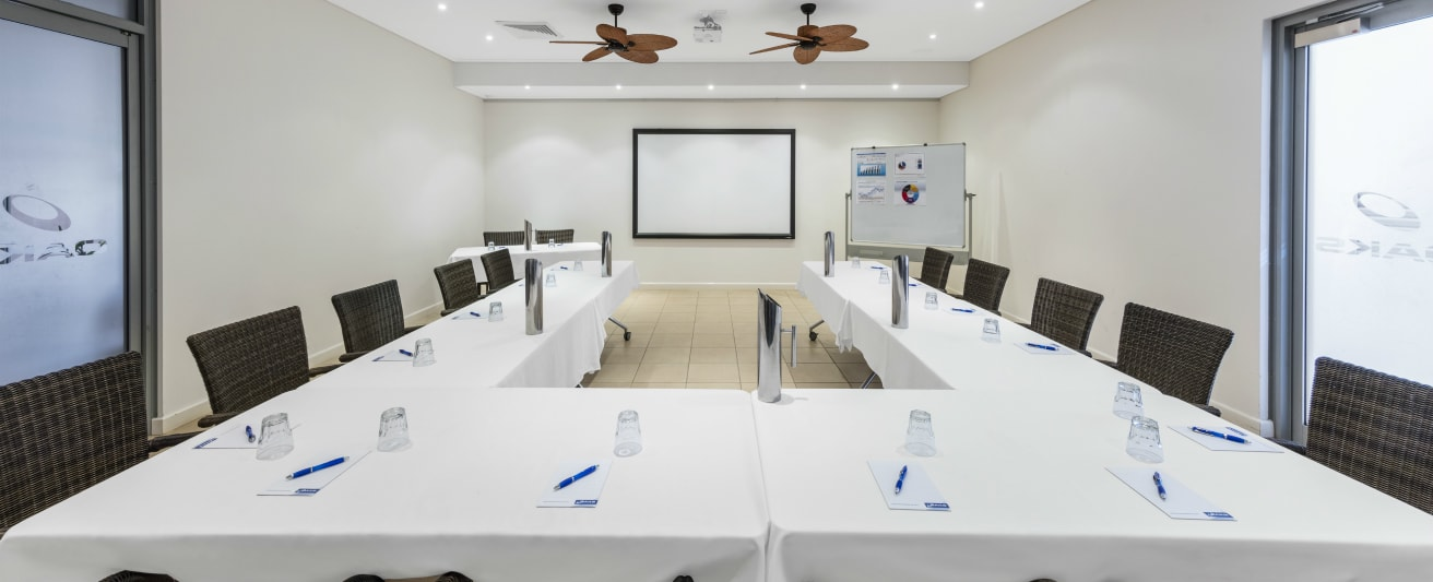 air conditioned conference room for hire with projector screen and white board for presentations in Broome, Western Australia