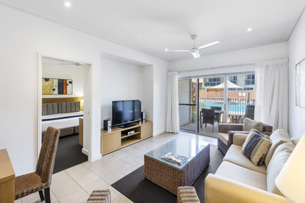 big air conditioned living room with comfortable couches, Foxtel and ceiling fan in 2 bedroom hotel apartment in Broome, Western Australia
