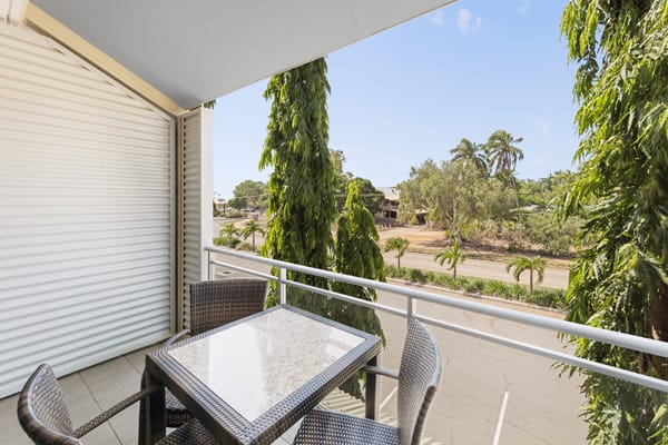 small private balcony with table and chairs outside Studio Apartment at Oaks Broome hotel in Western Australia