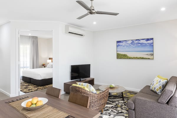 air conditioned hotel accommodation living room with Wi-Fi access, Foxtel on TV, comfortable couches and private balcony outside at Oaks Cable Beach Sanctuary in Broome, Western Australia