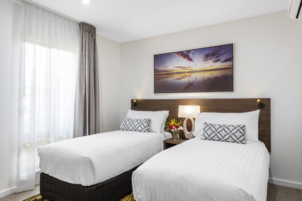 two single beds for children in air conditioned hotel bedroom with free Wi-Fi at Oaks Cable Beach Sanctuary in Broome, Western Australia