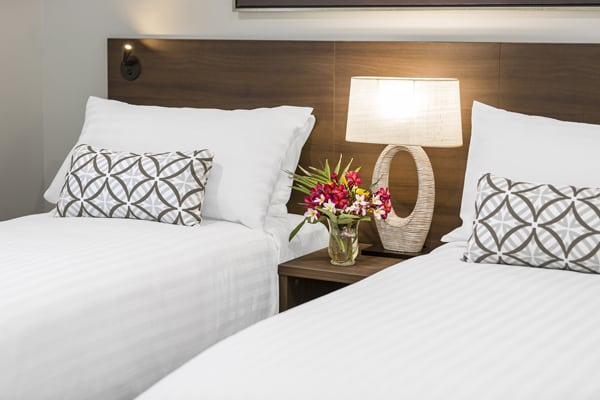 two single beds in bedroom of air conditioned hotel Studio apartment with Wi-Fi at Oaks Cable Beach Sanctuary in Broome, Western Australia