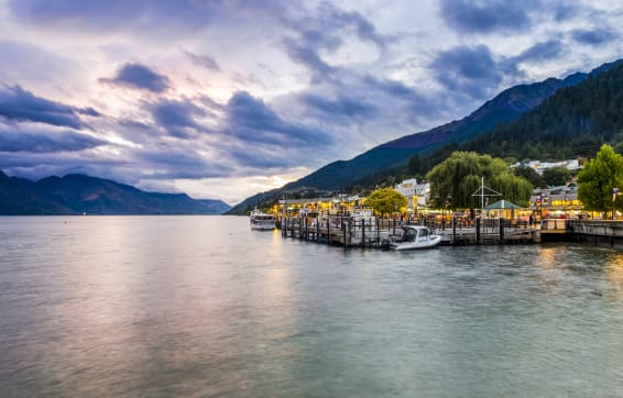 Sun setting in winter over Lake Wakatipu near Oaks resort accommodation Queenstown, New Zealand