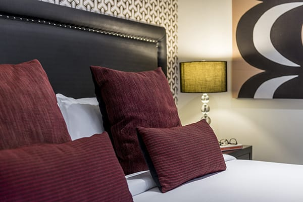 comfortable pillows on clean white sheets of double bed in 1 Bedroom Lake View Apartment at Oaks Club Resort hotel in Queenstown, New Zealand
