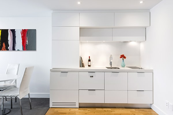 1 Bedroom hotel apartment kitchen with modern appliances including microwave, refrigerator, toaster and kettle for guests on family holiday at Oaks Club Resort hotel in Queenstown, New Zealand