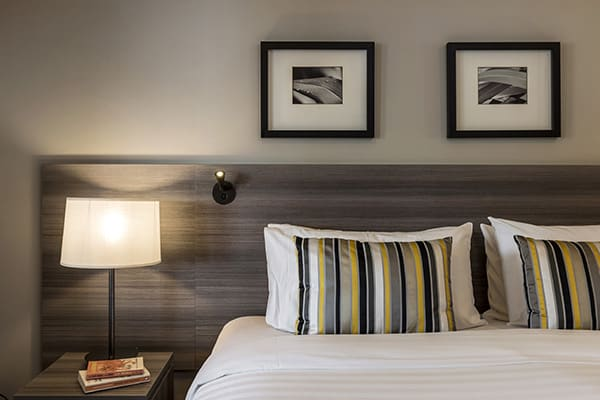 comfortable double bed with clean sheets in 2 bedroom holiday apartment with Wi-Fi and Sky TV at Oaks Shores hotel in Queenstown, New Zealand