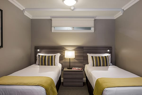two single beds for children staying in 3 Bedroom Holiday Apartment in Queenstown near bungy jumping
