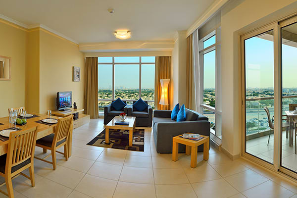 Living Room in Premier Apartment at Oaks Liwa Heights